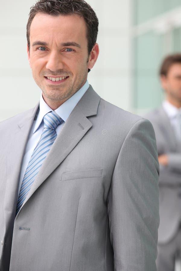 Smiling businessman stock photos
