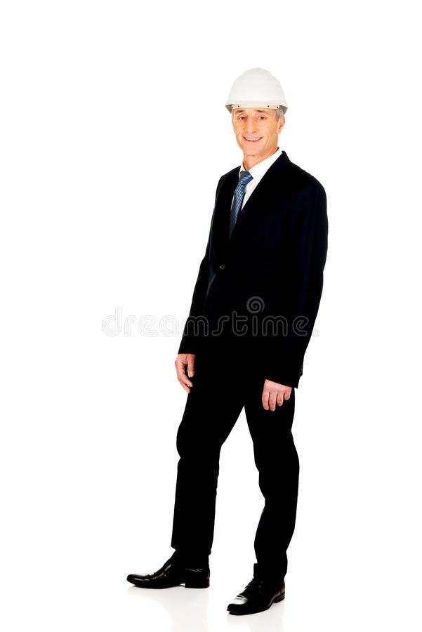 Smiling businessman with hard hat. Smiling mature engineer with hard hat royalty free stock photos