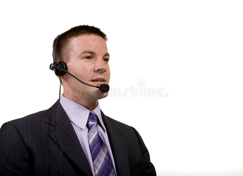Smiling Businessman On a Headset royalty free stock images