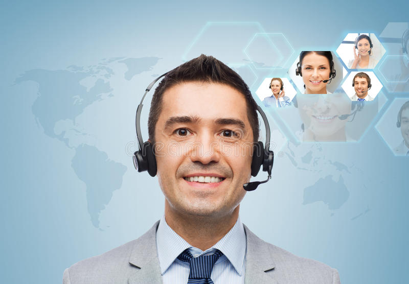 Smiling businessman in headset royalty free stock photography