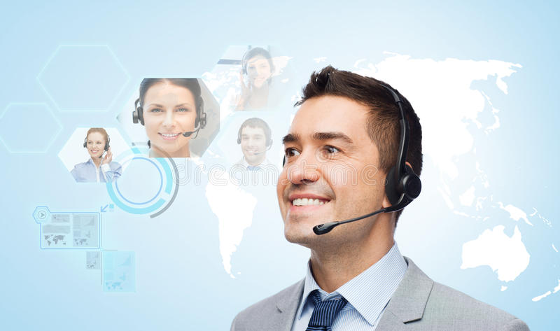 Smiling businessman in headset royalty free stock photos