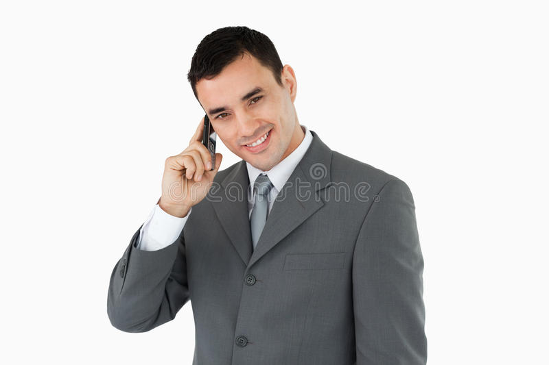 Smiling businessman on his phone