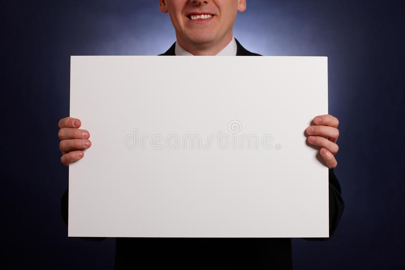 Download Smiling Businessman Holding A Big Blank Card Stock Photo - Image: 12700158