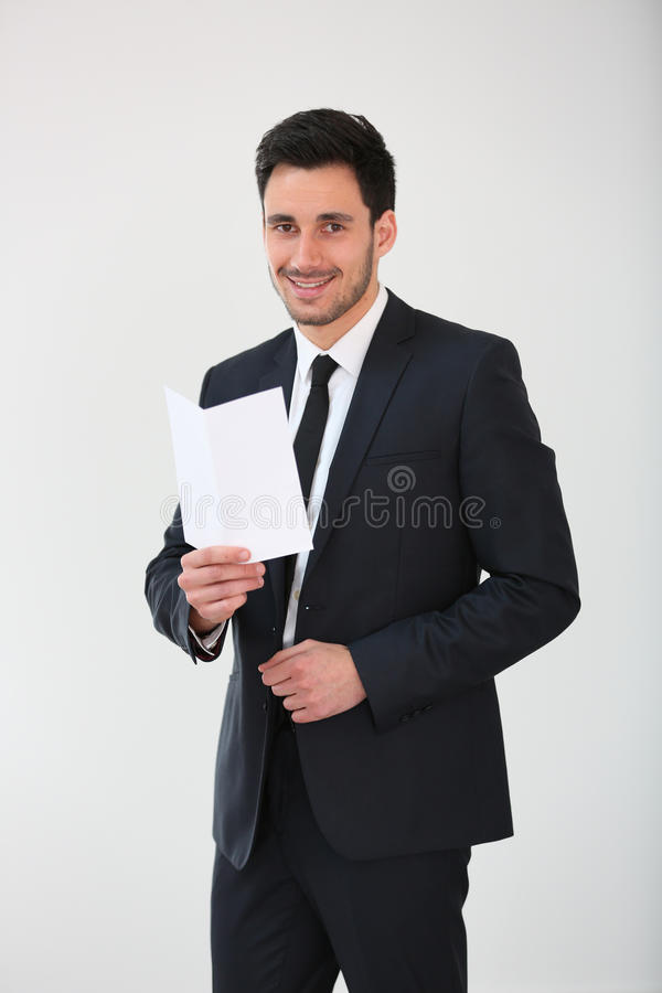 Smiling businessman holding a blank paper royalty free stock image