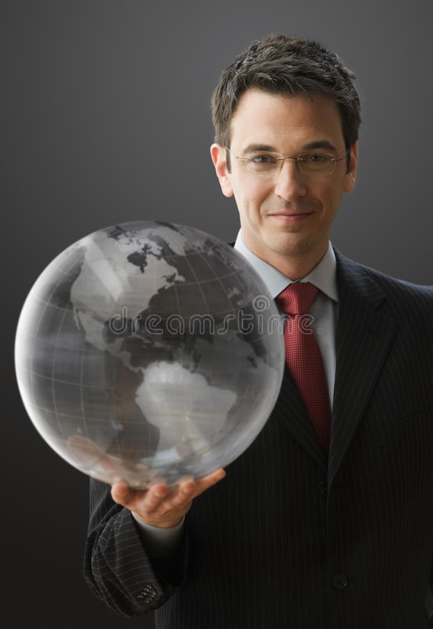 Smiling Businessman Holding A Globe Royalty Free Stock Photos