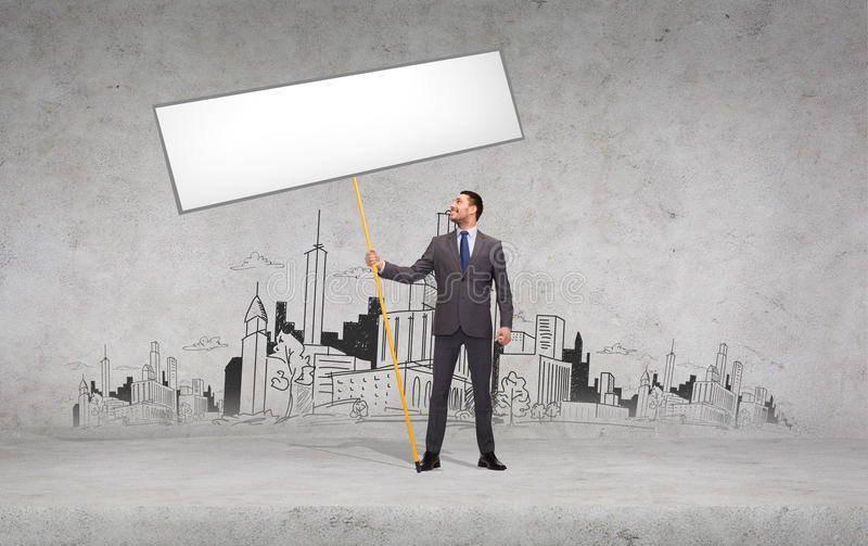 Smiling businessman holding white blank board. Business and advertisement concept - smiling businessman holding white blank board royalty free stock images