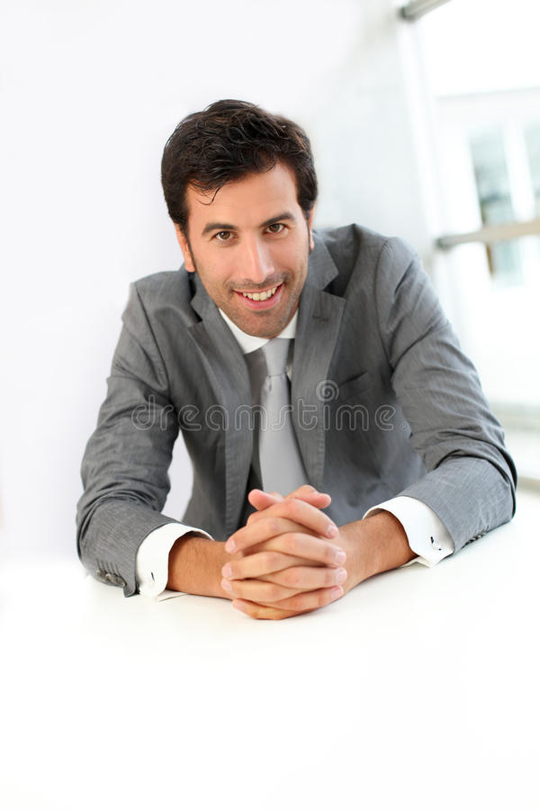 Smiling businessman listening to client royalty free stock photography