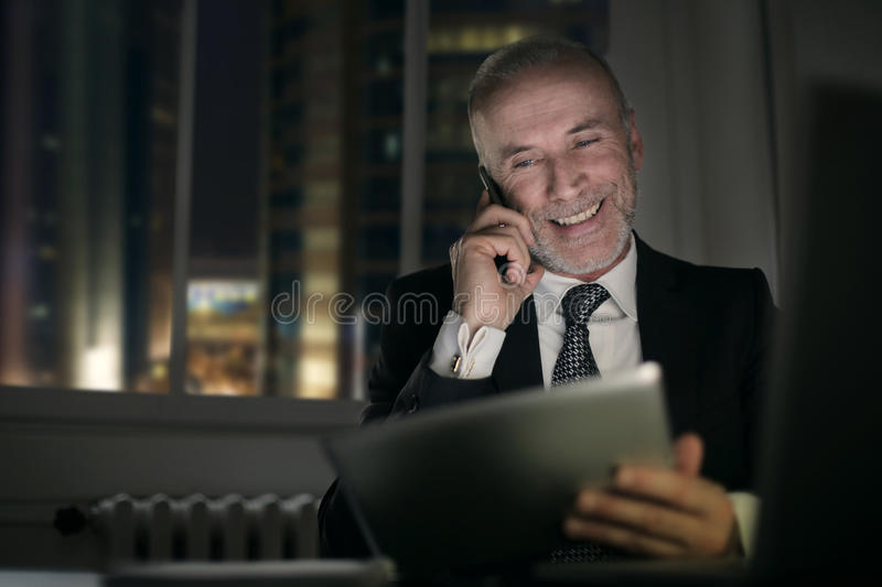 Smiling businessman. Making a call stock photo