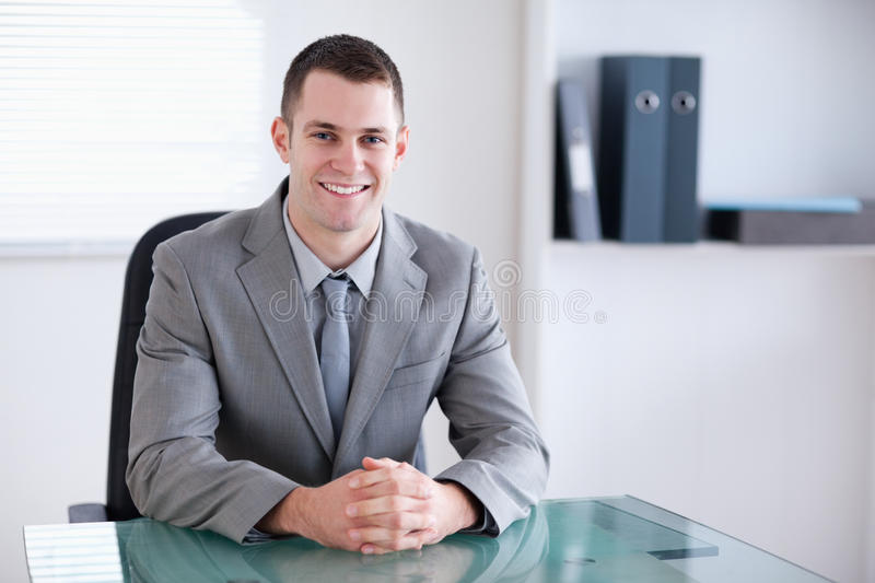Smiling businessman in a meeting stock image