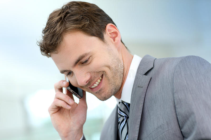 Smiling businessman negotiating on the phone stock images