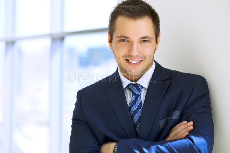 Smiling businessman in office stock images