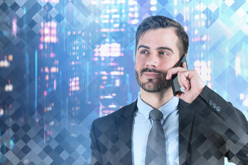 Smiling businessman on phone in night city stock images
