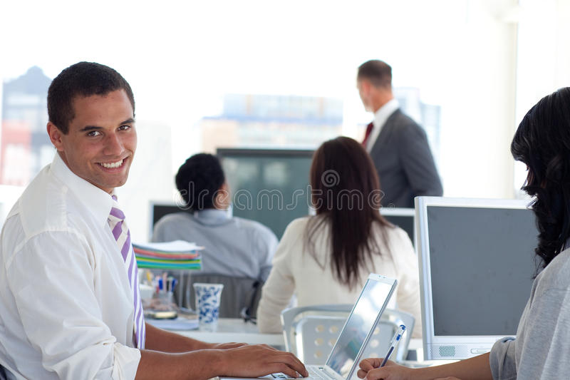 Smiling businessman in a presentation stock images
