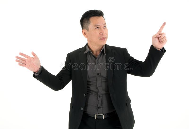 Smiling Businessman showing and pin pointing on something isolated on white background royalty free stock photos
