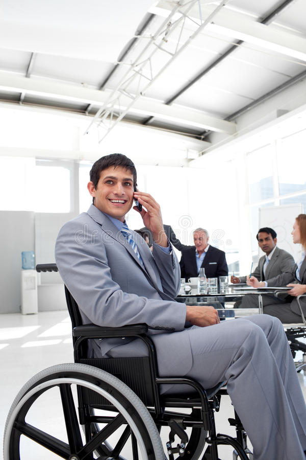 Download Smiling Businessman Sitting In A Wheelchair Stock Photo - Image: 12118714