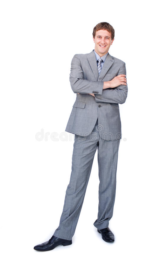 Smiling businessman standing with folded arms
