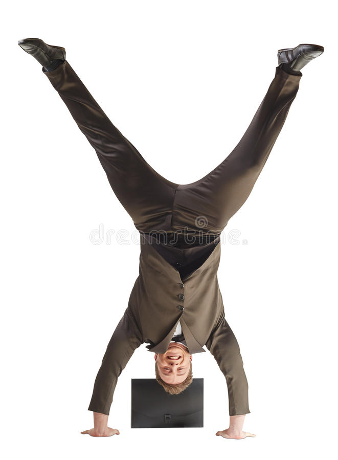 Smiling businessman standing on hands royalty free stock images