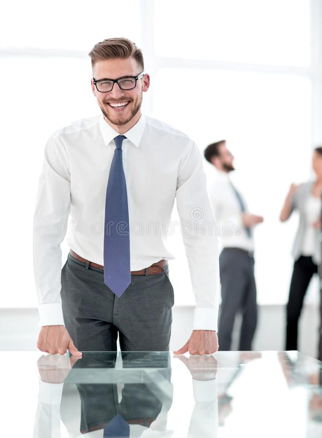 Smiling businessman standing in new office royalty free stock photos