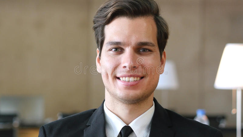 Smiling Businessman in Suit, Portrait in Office stock images