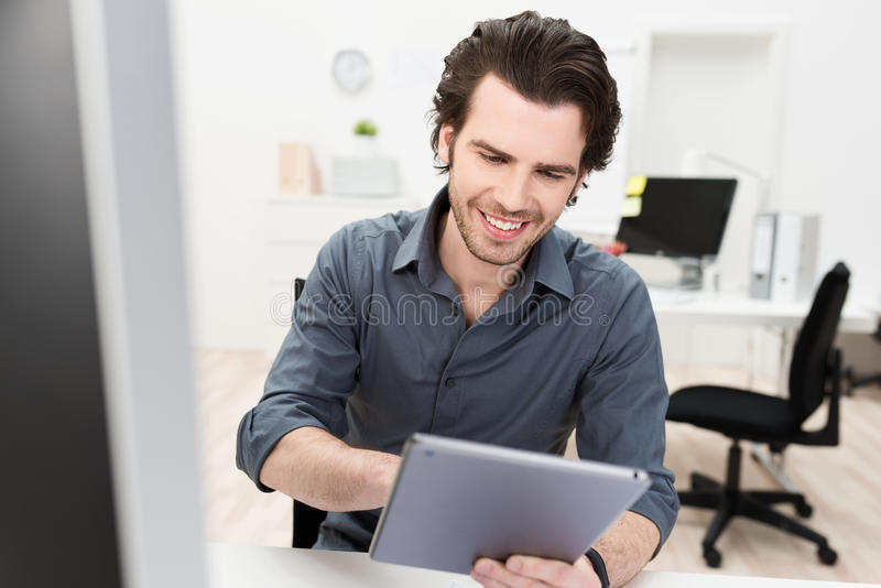 Smiling businessman surfing the internet stock images