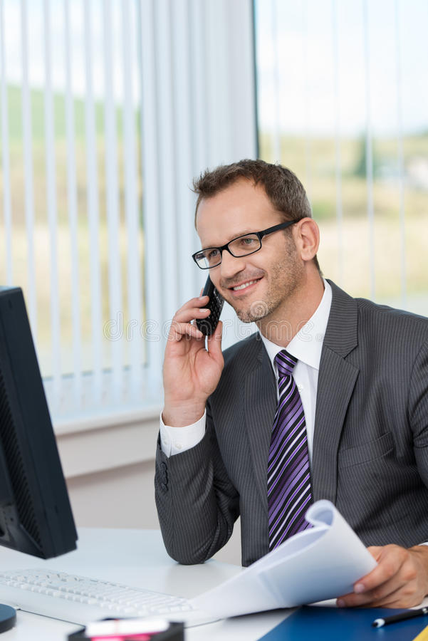 Download Smiling Businessman Talking On The Phone Stock Image - Image: 34293259