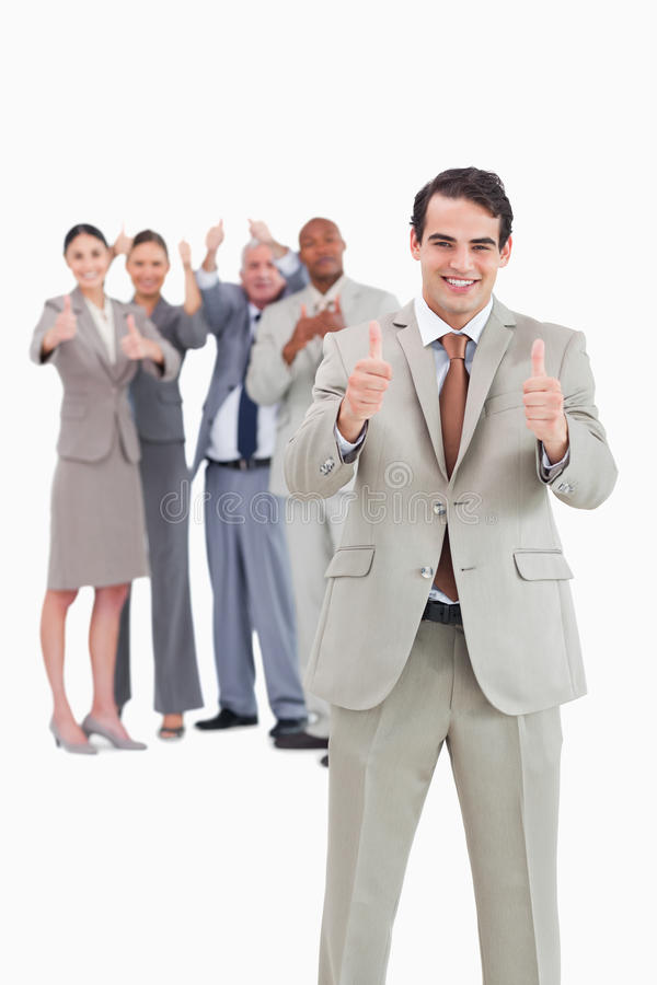 Download Smiling Businessman With Team Behind Him Stock Photo - Image: 22859358