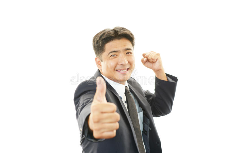 Download Smiling Businessman With Thumbs Up Stock Photo - Image of challenge, excitement: 39507588