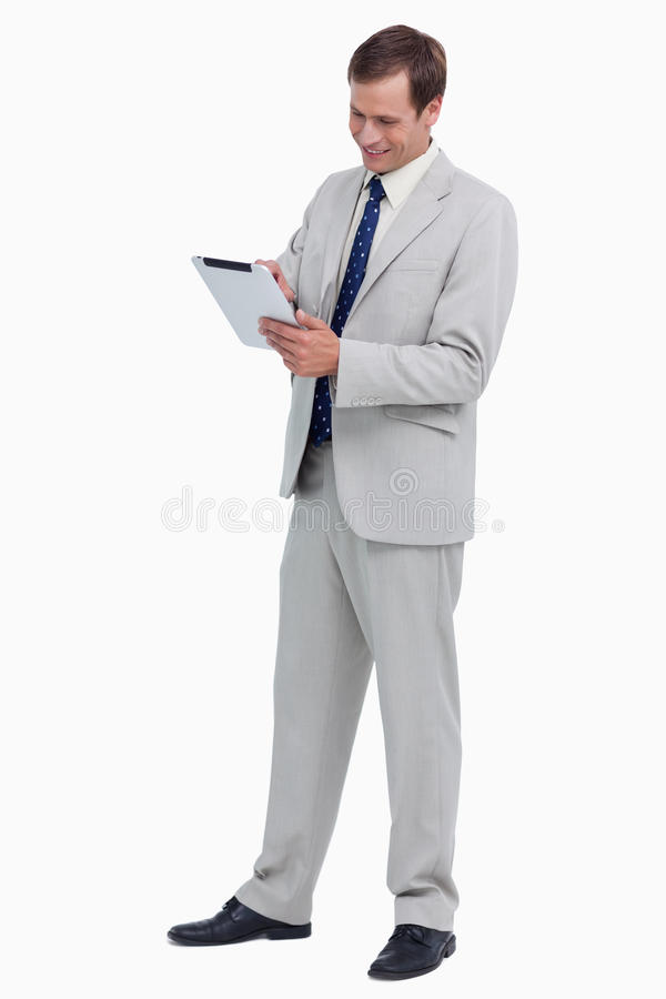 Download Smiling Businessman Using Tablet Computer Stock Photo - Image: 23016236