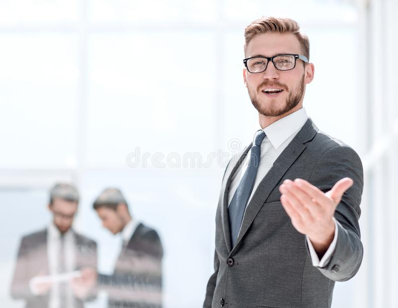 Smiling businessman welcome handshake royalty free stock image