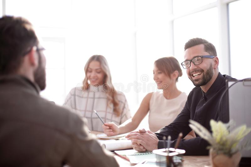 Smiling businessman at a working meeting in the office stock photos