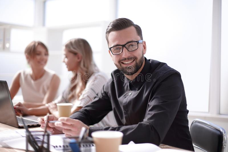 Smiling businessman in the workplace in the office royalty free stock images