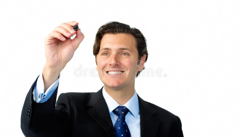 Smiling businessman writes with a marker in midair royalty free stock images