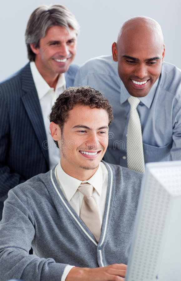 Smiling businessmen working at a computer