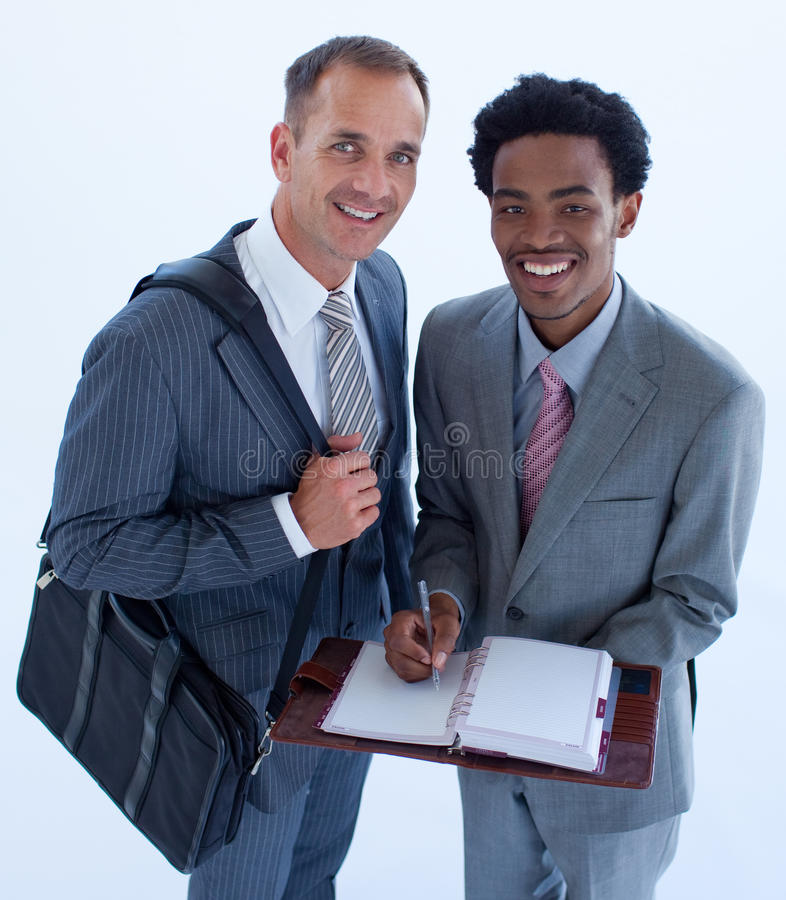 Smiling Businessmen Writing In A Business Diary Stock Photos