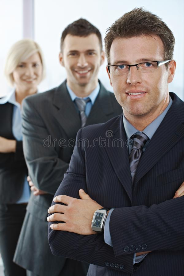 Businesspeople smiling at camera royalty free stock photography