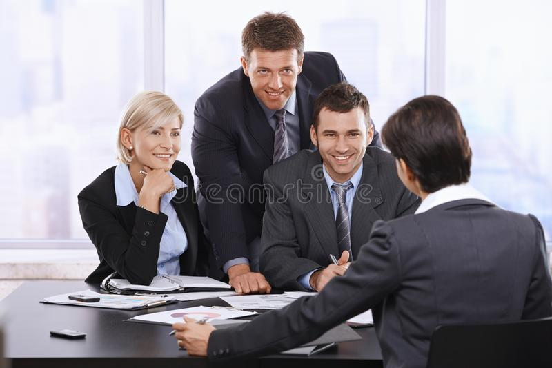 Smiling businesspeople stock photo