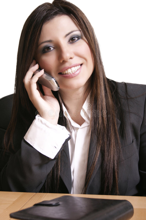 Smiling Businesswoman. Business woman on a cellphone stock images