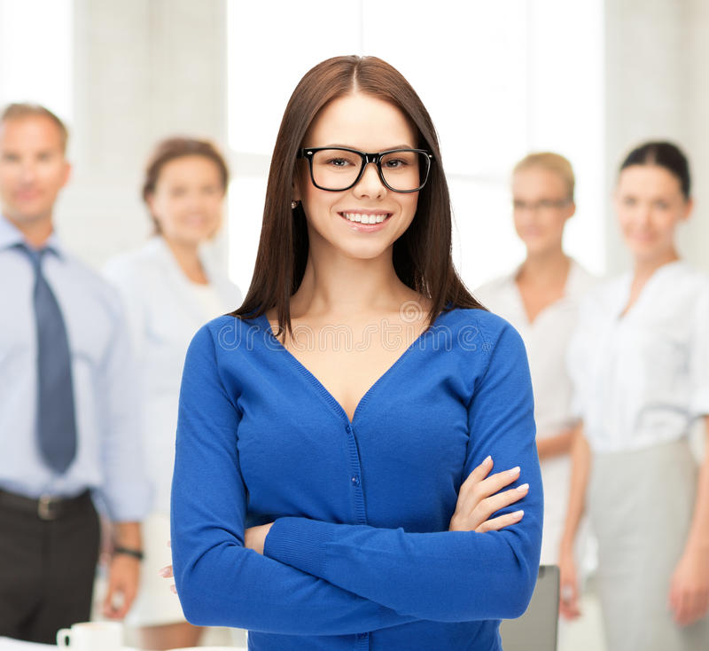 Smiling businesswoman. Office, buisness, teamwork concept - friendly young smiling businesswoman stock photography