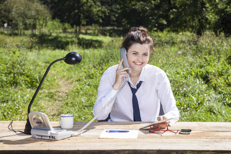 Smiling businesswoman analyze data royalty free stock image