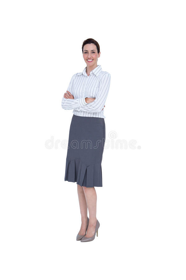Smiling businesswoman with arms crossed looking at camera. On white background stock photography