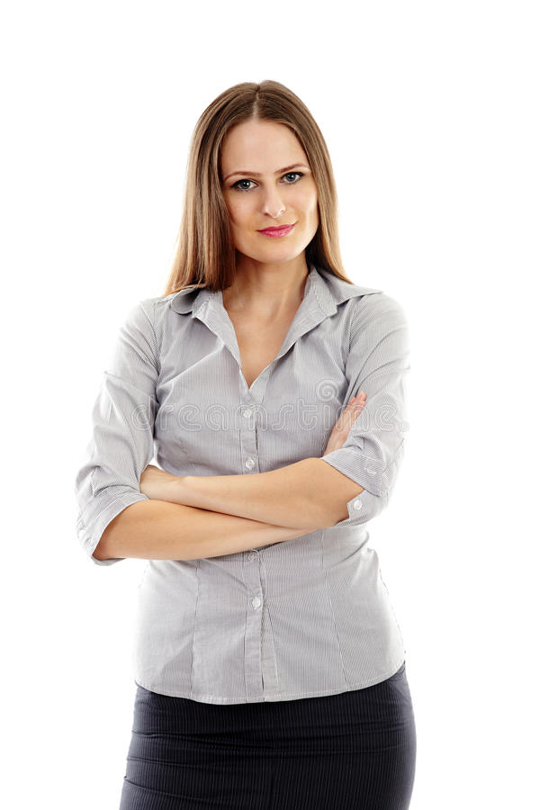 Smiling businesswoman with arms folded