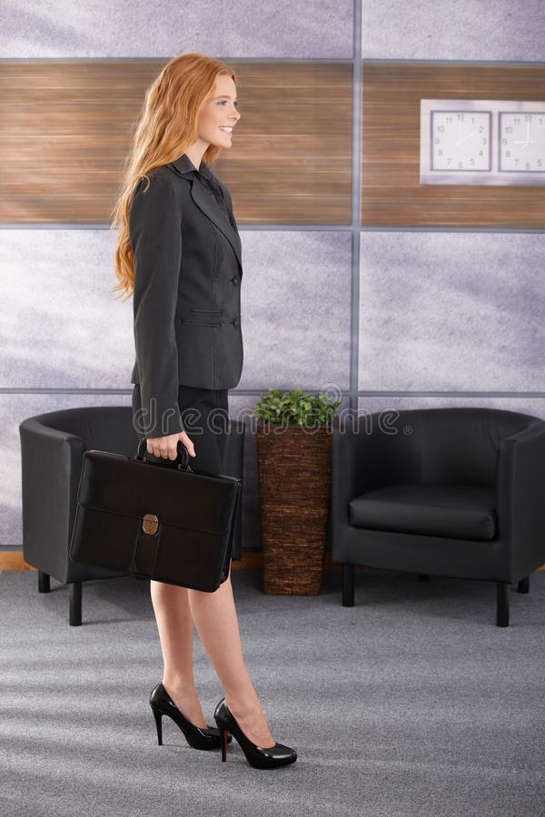 Smiling businesswoman arriving to office royalty free stock photos