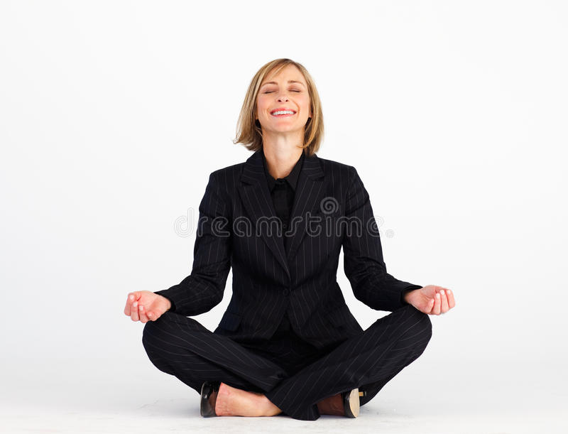 Download Smiling Businesswoman Doing Yoga Exercises Stock Photo - Image: 10428264
