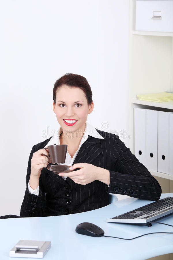 Download Smiling Businesswoman Drinking Coffee. Stock Photo - Image: 21682718