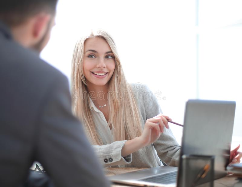 Smiling businesswoman explaining something to her colleague stock photography