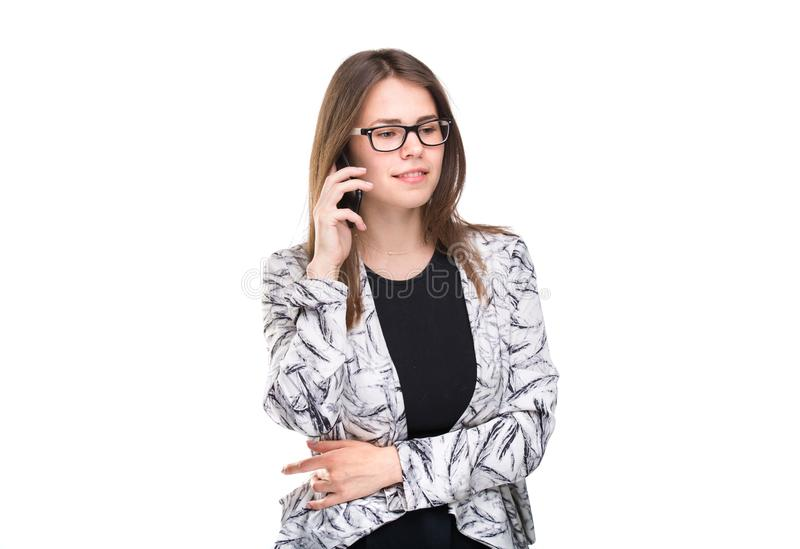 Smiling businesswoman in glasses talking on mobile phone. Beautiful young girl in Blazer on white isolated background stock photos
