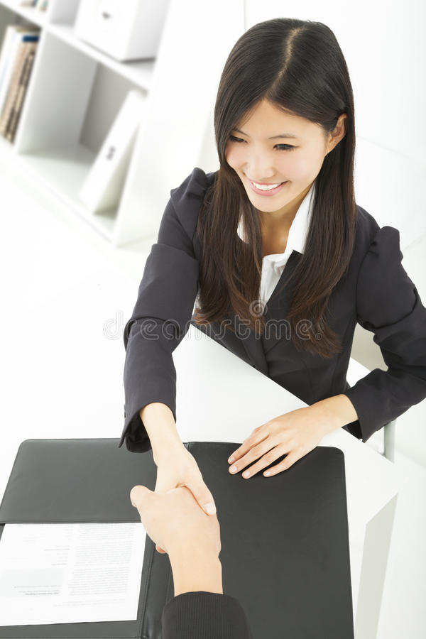 Download Smiling Businesswoman Handshaking With Businessman Stock Photography - Image: 33042262