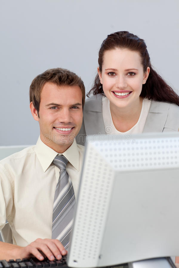 Download Smiling Businesswoman Helping Her Colleague Stock Photo - Image: 12715848