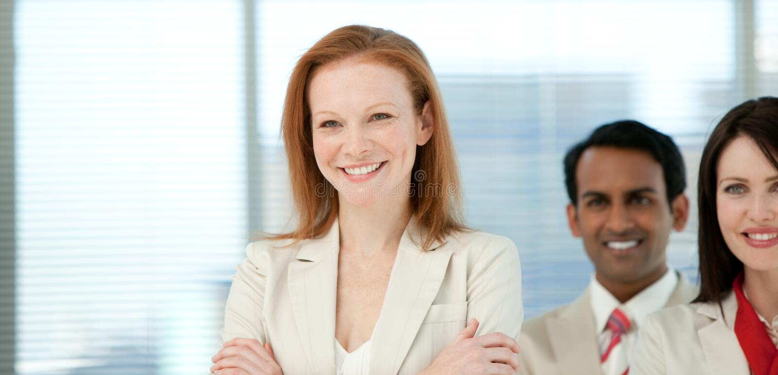 Smiling businesswoman with her colleagues stock images