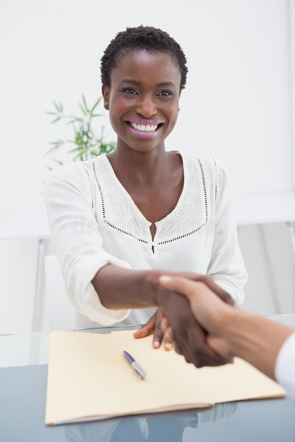 Smiling businesswoman introduced her new colleague royalty free stock photo